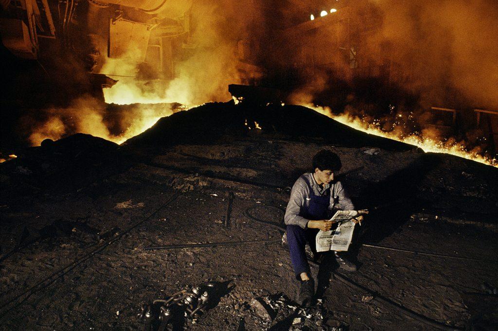 00038_18, MKS Steelworks, Serbia, Yugoslavia, 11/1989, SERBIA-10004. Man takes a break at MKS Steelworks. © Steve McCurry